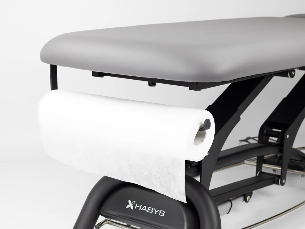Súčasťou stolíka je praktický vešiak na jednorazovú podložku v rolke.